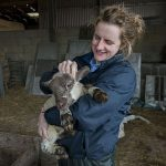 Emily Gascoigne with a lamb